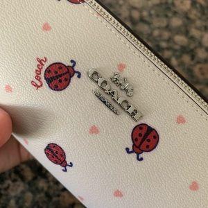 Coach Bags - Coach leather ladybug brush holder bag